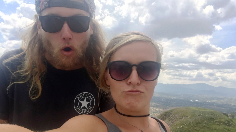 In this undated photo provided by the Deese family of Chynna Deese, 23-year-old Australian Lucas Fowler, left, and 24-year-old American girlfriend Chynna Deese poses for a selfie. The couple were found murdered along the Alaska Highway near Liard Hot Springs, Canada, on Monday, July 15, 2019. (Deese Family via AP)
