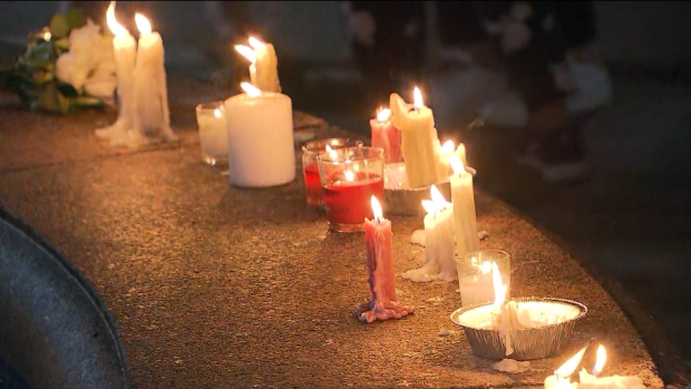 Candles are lit at Alexander the Great Parkette on Danforth Avenue Monday July 22, 2019 to mark the one-year anniversary of a mass shooting.