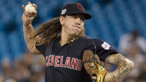 Cleveland Indians starting pitcher Mikel Clevinger throws during first inning American League MLB baseball action against the Toronto Blue Jays, in Toronto, Monday, July 22, 2019. THE CANADIAN PRESS/Fred Thornhill