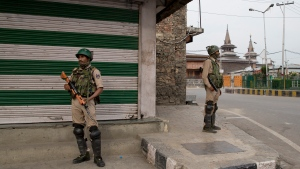 FILE- In this July 13, 2019 file photo, Indian paramilitary soldiers stand guard at a closed market area during a strike called by separatists in Srinagar, Indian controlled Kashmir. India's opposition leaders are angrily demanding Prime Minister Narendra Modi clarify his position in Parliament about President Donald Trump mediating India's long-running dispute with Pakistan over Kashmir. Indian External Affairs Minister S. Jaishankar said in Parliament on Tuesday that Modi made no such request to Trump as the U.S. president had claimed. (AP Photo/Dar Yasin, File)