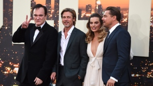 "From left, director Quentin Tarantino poses with cast members Brad Pitt, Margot Robbie and Leonardo DiCaprio at the Los Angeles premiere of ""Once Upon a Time in Hollywood,"" at the TCL Chinese Theatre, Monday, July 22, 2019. (Photo by Jordan Strauss/Invision/AP)"