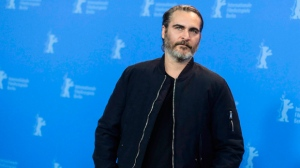 Actor Joaquin Phoenix poses at a photo call for the film 'Don't Worry, He Won't Get Far On Foot', during the 68th edition of the International Film Festival Berlin, Berlinale, in Berlin, Germany, Tuesday, Feb. 20, 2018. Phoenix acts coy when asked about rumours around him possibly playing the Joker in a Batman villain-origin movie. THE CANADIAN PRESS/AP-Markus Schreiber