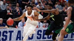 Syracuse forward Oshae Brissett (11) drives to the basket against Baylor guard Mario Kegler (4) during the second half of a first-round game in the NCAA men's college basketball tournament Thursday, March 21, 2019, in Salt Lake City. (AP Photo/Jeff Swinger)