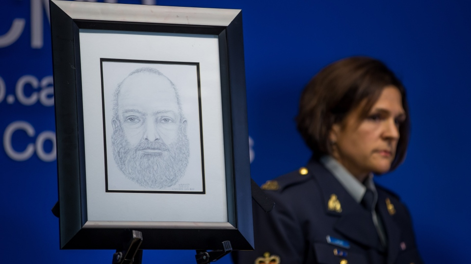 A sketch of a man who was found dead near Dease Lake, B.C., is displayed as RCMP Sgt. Janelle Shoihet listens during an RCMP news conference regarding missing teenagers Kam McLeod and Bryer Schmegelsky, in Surrey, B.C., on Monday July 22, 2019. THE CANADIAN PRESS/Darryl Dyck