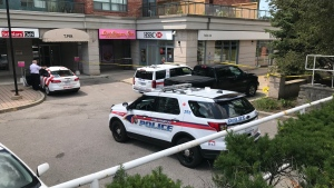 Police are shown at the scene of a bank robbery investigation in Thornhill.
