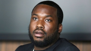 In this Tuesday, July 23, 2019 photo, Meek Mill makes an announcement of the launch of Dream Chasers record label in joint venture with Roc Nation, at the Roc Nation headquarters in New York.   A Pennsylvania appeals court has thrown out rapper Meek Mill's decade-old conviction in a drug and gun case. The unanimous three-judge opinion Wednesday grants the rapper born Robert Williams a new trial because of new evidence of alleged police corruption. (Photo by Greg Allen/Invision/AP)