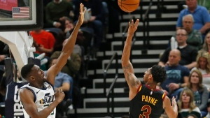 Cleveland Cavaliers guard Cameron Payne (3) shoots as Utah Jazz center Ekpe Udoh, left, defends during the second half in an NBA basketball game Friday, Jan. 18, 2019, in Salt lake City. (AP Photo/Rick Bowmer)