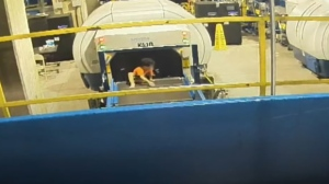 A toddler is seen on an Atlanta International Airport conveyor belt on July 22, 2019. (Atlanta Airport via AP)