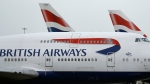 This Jan. 10, 2017 file photo shows British Airways planes parked at Heathrow Airport in London. On Saturday, July 20, 2019, British Airways said it is canceling flights to Cairo for a week for unspecified security reasons. (AP Photo/Frank Augstein, File)