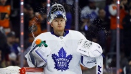 Toronto Maple Leafs' Frederik Andersen squirts water from his bottle after giving up a goal to Philadelphia Flyers' Radko Gudas during the second period of an NHL hockey game Wednesday, March 27, 2019, in Philadelphia. Frederik Andersen's busy off-season has seen him fly home to Denmark, spend time honing his skills in California, and attend a couple of weddings, including the Jewish nuptials of Maple Leafs winger Zach Hyman. THE CANADIAN PRESS/AP, Matt Slocum