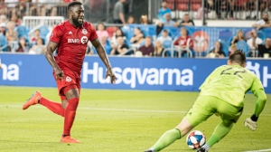 Toronto FC forward Jozy Altidore (17) takes a shot on FC Cincinnati goalkeeper Przemyslaw Tyton (22) during first half MLS soccer action, in Toronto, Saturday, July 27, 2019. THE CANADIAN PRESS/Christopher Katsarov