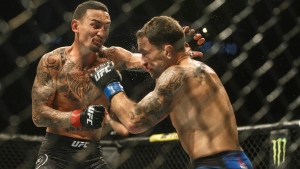 Max Holloway, left, fights Frankie Edgar during UFC 240, in Edmonton on Saturday, July 27, 2019. THE CANADIAN PRESS/Jason Franson