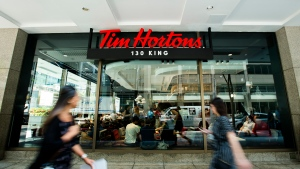 Consumer ambivalence is the reason Tims and many other quick service restaurants are rethinking how to reach millennial and Gen Z diners, say experts who point to similarly minded overhauls at McDonald's, Boston Pizza and Panera Bread. People walk past the newly renovated Tim Hortons in Toronto on Thursday, July 25, 2019. THE CANADIAN PRESS/Nathan Denette