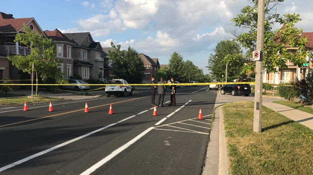 Police are seen on Castlemore Avenue in Markham after four people were found dead in a home on the afternoon of July 28, 2019. (Brandon Rowe/CTV News Toronto)