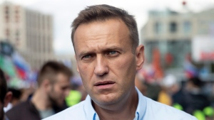 FILE - In this file photo taken on Saturday, July 20, 2019, Russian opposition activist Alexei Navalny attends a protest in Moscow, Russia. (AP Photo/Pavel Golovkin, File)