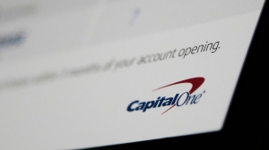 FILE - Capital One says a hacker got access to the personal information of over 100 million individuals applying for credit. The McLean, Virginia-based bank said Monday, July 29, 2019, it found out about the vulnerability in its system July 19 and immediately sought help from law enforcement to catch the perpetrator. (AP Photo/Elise Amendola)