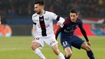 Toronto FC has signed French winger Nicolas Benezet. Guingamp's Nicolas Benezet, left, duels for the ball with PSG's Angel Di Maria during the French League One soccer match between Paris Saint Germain and Guingamp at the Parc des Princes stadium in Paris, Sunday, April 29, 2018. THE CANADIAN PRESS/AP-Thibault Camus