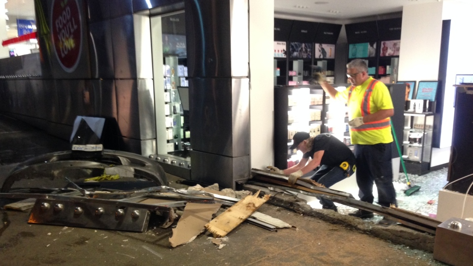 Police say a driver who hit a pedestrian and then crashed into a Shoppers Drug Mart near College Park has been arrested. (Cam Woolley/ CP24)