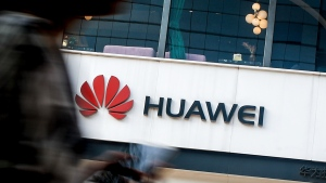 A woman walks by a Huawei retail store in Beijing, Tuesday, July 30, 2019. Huawei's global sales rose by double digits in the first half of this year despite being placed on a U.S. security blacklist. The Chinese tech giant's chairman said Washington's campaign against the company has 'galvanized our people.'(AP Photo/Andy Wong)