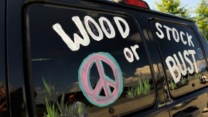 """This Aug. 14, 2009 file photo shows a van decorated with """"Woodstock or Bust"""" at the original Woodstock Festival site in Bethel, N.Y. (AP Photo/Stephen Chernin, File)"""