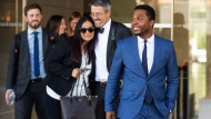 "Rapper Marcus Gray, right, smiles as his attorney, Michael A. Kahn, second from right, congratulates Gray's wife, Crystal, as they leave the federal courthouse in Los Angeles, Thursday, Aug. 1, 2019. A jury has decided that Katy Perry, her collaborators and her record label must pay more than $2.78 million because the pop star's 2013 hit ""Dark Horse"" copied a Christian rap song by Gray. Perry's attorney said they plan to vigorously fight the decision. (AP Photo/Damian Dovarganes)"