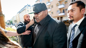 One of A$AP Rocky's bodyguards arrives at the district court in Stockholm, Friday Aug. 2, 2019, the third day of A$AP Rocky's trial. American rapper A$AP Rocky testified Thursday at his assault trial that he did everything possible to avoid a confrontation with two men he said were persistently following his entourage in Stockholm, but one of those men picked a fight with one of his bodyguards. (Fredrik Persson/TT via AP)