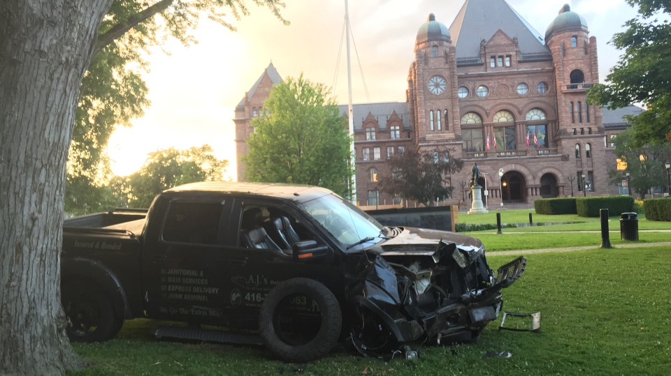 A pick-up truck was involved in a collision at Queen's Park on Saturday night. (CTV News/Ricardo Alfonso)