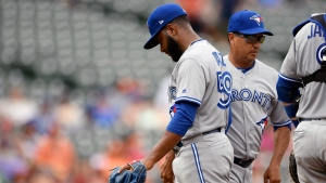 Toronto Blue Jays' relief pitcher Yennsy Diaz, left, is pulled from a baseball game by manager Charlie Montoyo, right, during the fifth inning against the Baltimore Orioles, Sunday, Aug. 4, 2019, in Baltimore. (AP Photo/Nick Wass)