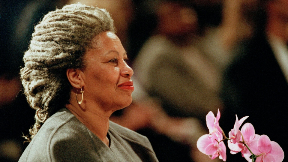 In this April 5, 1994 file photo, Toni Morrison as she holds an orchid at the Cathedral of St. John the Divine in New York. (AP Photo/Kathy Willens, File)