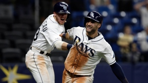 Tampa Bay Rays' Kevin Kiermaier, right, celebrates with Michael Brosseau after Kiermaier scored on a wild pitch by Toronto Blue Jays reliever Buddy Boshers during the 10th inning of a baseball game Tuesday, Aug. 6, 2019, in St. Petersburg, Fla. (AP Photo/Chris O'Meara)