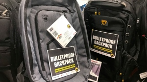 This Thursday, Aug. 8, 2019 photo shows bulletproof backpacks that for sale at an Office Depot store in Evanston, Ill.. With the rise of mass shooting, companies like Guard Dog Security, TuffyPacks and Bulletblocker are creating bullet-resistant backpacks for children for the back-to-school shopping season. Many say they're seeing an increase in sales in their products leading up to the fall, and typically see a spike in sales after a mass shooting. (AP Photo/Teresa Crawford)