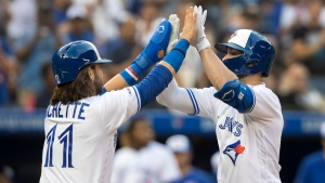 Toronto Blue Jays Randall Grichuk celebrates at home plate with teammate Bo Bichette after Grichuk hit two run home run against the New York Yankees during the first inning of their American League MLB baseball game in Toronto Friday August 9, 2019. (THE CANADIAN PRESS/Fred Thornhill)