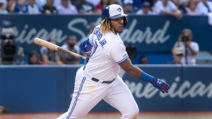 Toronto Blue Jays' Vladimir Guerrero Jr. hits a triple to score two runs in the seventh inning of their American League MLB baseball game against the New York Yankees in Toronto Saturday August 10, 2019. THE CANADIAN PRESS/Fred Thornhill