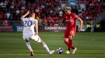 Toronto FC midfielder Alejandro Pozuelo (10) dribbles past Orlando City midfielder Oriol Rosell (20) during first half MLS soccer action in Toronto, on Saturday, August 10, 2019. (THE CANADIAN PRESS/Christopher Katsarov)