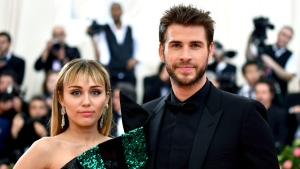 "Miley Cyrus and Liam Hemsworth have separated after less than a year of marriage. A representative for the singer said Saturday, Aug. 10 the pair decided a break was best while they focus on ""themselves and careers."" (Photo by Charles Sykes/Invision/AP, File)"