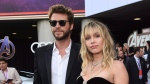 "Liam Hemsworth, left, and Miley Cyrus arrive at the premiere of ""Avengers: Endgame"" at the Los Angeles Convention Center on Monday, April 22, 2019. (Photo by Chris Pizzello/Invision/AP)"