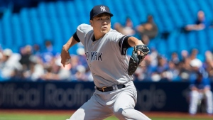 New York Yankees starting pitcher Masahiro Tanaka throws against the Toronto Blue Jays during the first inning of their American League MLB baseball game in Toronto, Sunday, August 11, 2019. THE CANADIAN PRESS/Fred Thornhill