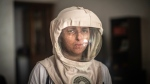 In this Tuesday, July 16, 2019 photo, Fatimazehra El Ghazaoui, 27, a woman affected by a rare disorder called xeroderma pigmentosum, or XP, poses for a portrait wearing a protective mask she wears outside on sunny days, in her home in Mohammedia, near Casablanca, Morocco. (AP Photo/Mosa'ab Elshamy)