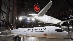 Air Canada says it will spend more to buy Transat A.T. Inc., upping its total offer by $200 million and winning the support of the tour company's largest shareholder. (File Photo/THE CANADIAN PRESS/Mark Blinch)