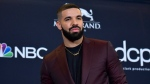 This May 1, 2019 file photo shows Drake at the Billboard Music Awards in Las Vegas. Drake is putting himself ahead of the Beatles after recently shattering another of the Fab Four's chart records. THE CANADIAN PRESS/AP-Photo by Richard Shotwell/Invision/AP, File