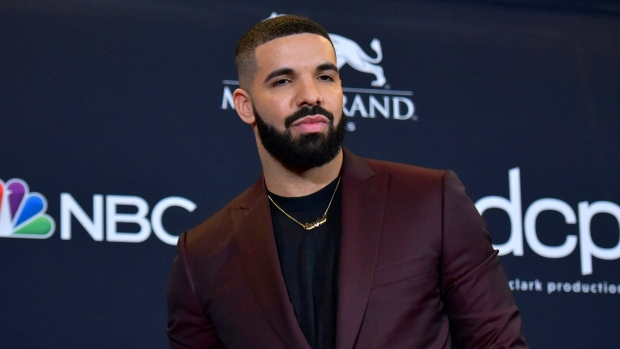 Drake Celebrates Surpassing The Beatles' Longstanding Records With 'Abbey Road'-Inspired Tattoo