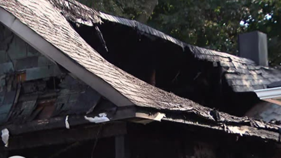 A burned-out home in Aurora where a man was found dead is pictured Saturday July 27, 2019.