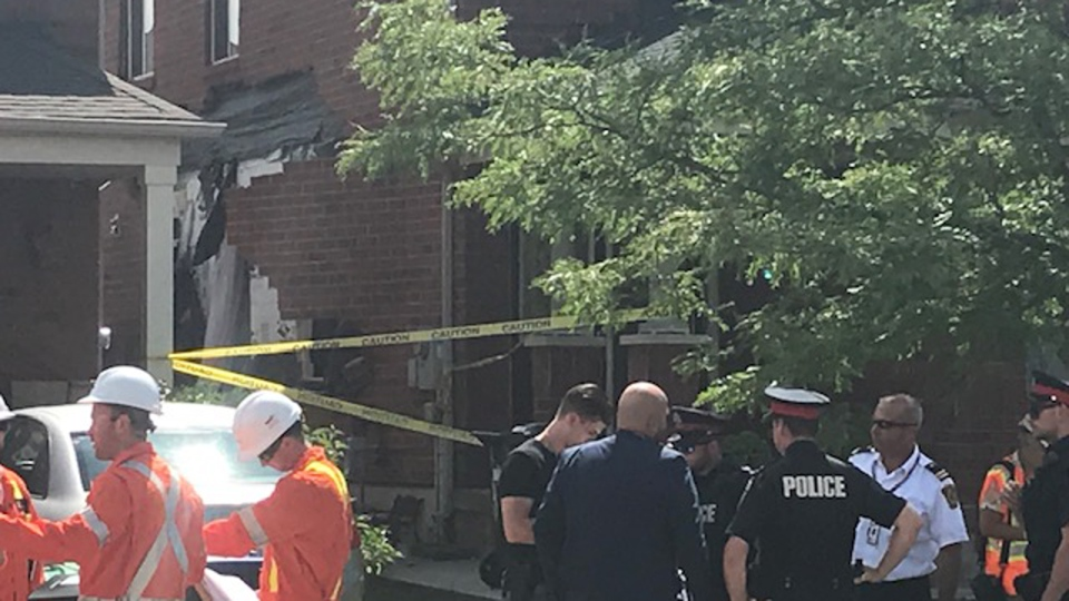First responders stand in front of a home in Brampton that exploded on Aug. 13, 2019. (Ron Dhaliwal/CTV News Toronto)