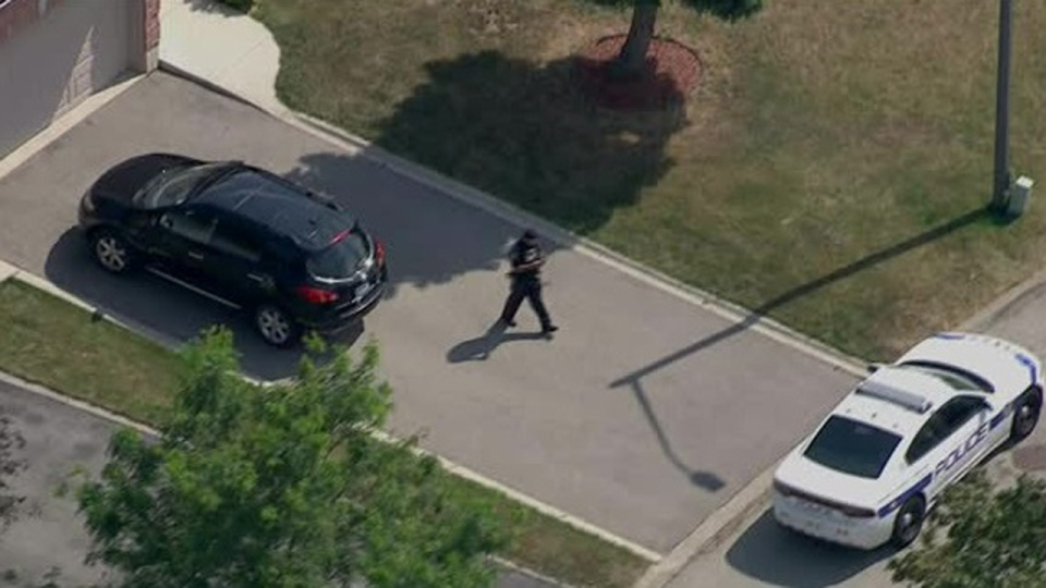 Peel Regional Police are seen outside a home in the Idlewilde Crescent and Erin Mills Parkway area after a shooting on Aug. 13, 2019. (Chopper 24)