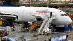 "FILE - This June 12, 2017, file photo shows a Boeing 787 being built for Norwegian Air Shuttle at Boeing Co.'s assembly facility in Everett, Wash. Norwegian Air says it's ending trans-Atlantic service between Ireland and three U.S. and Canadian airports because the grounding of Boeing 737 Max aircraft has made the routes ""no longer commercially viable."" (AP Photo/Ted S. Warren, File)"