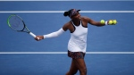 Venus Williams, of the United States, hits balls to the fans after her win against Kiki Bertens, of the Netherland, at the Western & Southern Open tennis tournament in Mason, Ohio, Tuesday, Aug. 13, 2019. (Sam Greene/The Cincinnati Enquirer via AP)