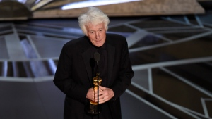 "Roger Deakins accepts the award for best cinematography for ""Blade Runner 2049"" at the Oscars on Sunday, March 4, 2018, at the Dolby Theatre in Los Angeles. Venerable cinematographer Deakins will be honoured at next month's Toronto International Film Festival. THE CANADIAN PRESS/AP-Photo by Chris Pizzello/Invision/AP"