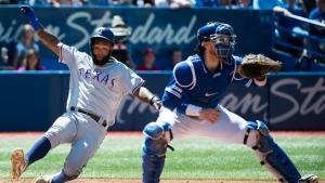 Texas Rangers first baseman Danny Santana (38) scores past Toronto Blue Jays catcher Danny Jansen during sixth inning American League MLB baseball action in Toronto on Wednesday, August 14, 2019. THE CANADIAN PRESS/Nathan Denette