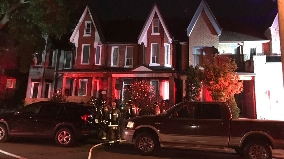 Firefighters respond to a fire at a home on Brock Avenue near College Street Thursday August 15, 2019. (Mike Nguyen /CP24)