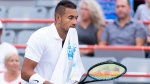 Nick Kyrgios of Australia walks across the court with a towel in his mouth during a break in play in his match against Kyle Edmund of Germany during first round of play at the Rogers Cup tennis tournament Tuesday August 6, 2019 in Montreal. THE CANADIAN PRESS/Paul Chiasson